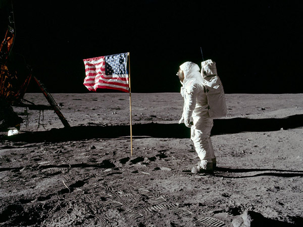 Apollo 11 Aldrin poses next to the Stars and Stripes
