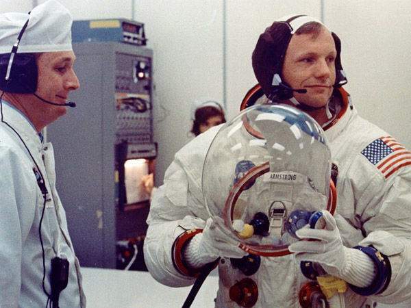 Apollo 11 Neil Armstrong gets fitted into his pressure suit
