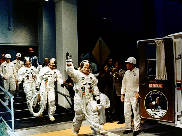 The Apollo 11 crew head for the van
